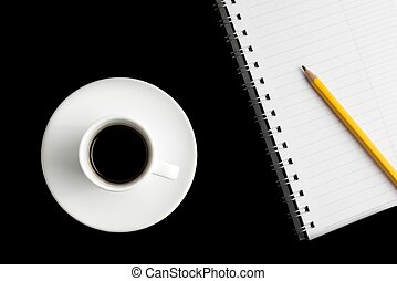 cup of black coffee with notepad