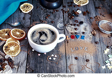 cup of black hot coffee on a gray wooden surface