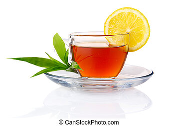 Cup of black tea with lemon and green leaves isolated on white background