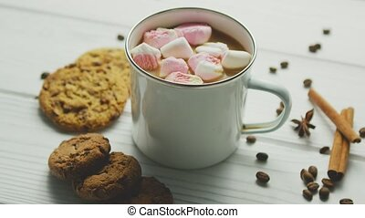 Cup of cacao with marshmallows - White mug filled with sweet...