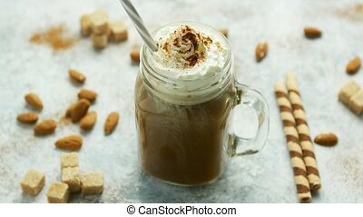 Cup of cacao with whipped cream and caramel - Glass jar with...