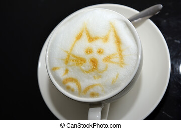 Cup of Cappuccino Coffee with a foam shaped as cat face