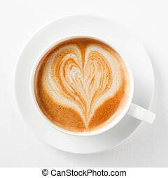 Cup of cappuccino coffee with a heart