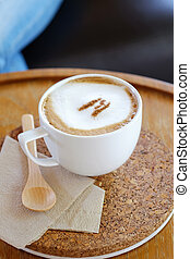 Cup of cappuccino on wood table