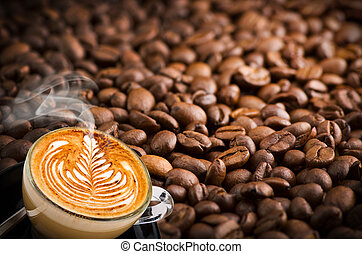 cup of cappuccino with coffee beans background