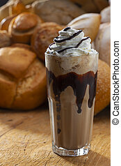 cup of cappuccino with whipped cream and chocolate chips, ...