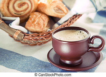 Cup of cofee with cinnamon Danish bun