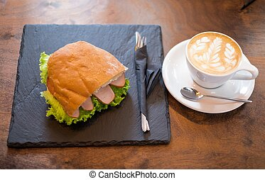 Cup of coffee and a sandwich