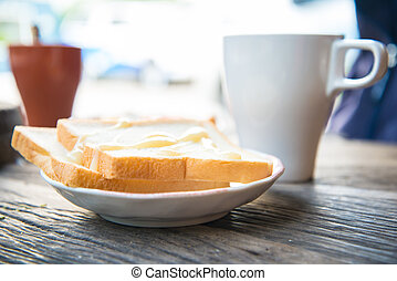 coffee and a slice of bread