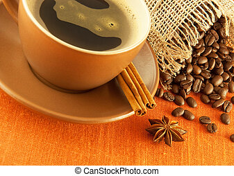 Cup of coffee and bag of grains in bulk on a orange background