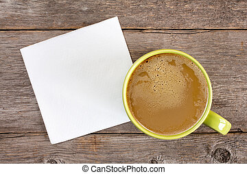 Cup of coffee and blank napkin