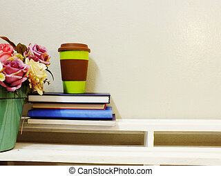cup of coffee and book on wooden table