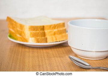 Cup of coffee and bread