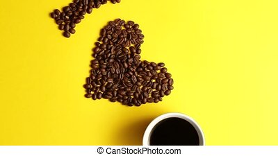 Cup of coffee and brown beans - From above view of mug of...