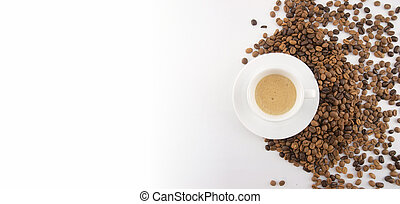 Cup of coffee and coffee beans on white