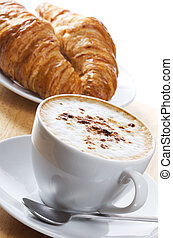 coffee and croissants - cup of coffee and croissants