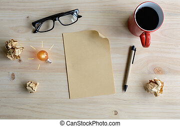 Cup of coffee and crumpled paper with blank paper on desk,
