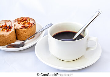 cup of coffee and delicious cake on