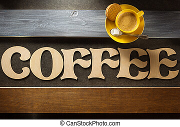 cup of coffee and letters at wood