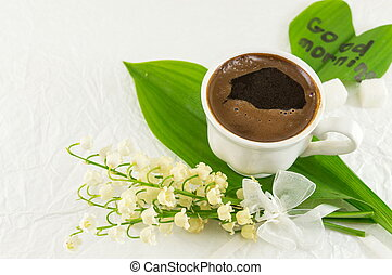 Cup of coffee and lily flowers