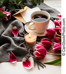 Cup of coffee and pink tulips