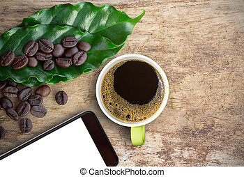 Cup of coffee and smart phone with coffee beans