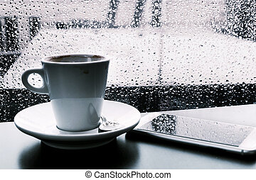 cup of coffee and smartphone on the rain