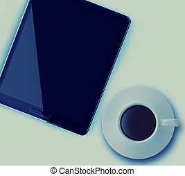 cup of coffee and tablet computer