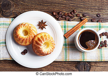 Cup of coffee and tasty cupcake