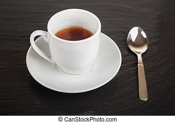 cup of coffee and teaspoon