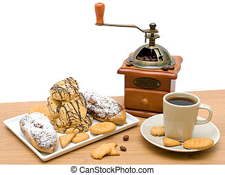 cup of coffee and various pastries on a white background