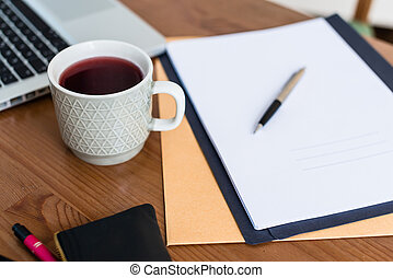 Cup of coffee at desk