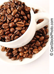 Close-up of white cup of coffee beans