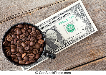 Cup of coffee beans on dollar banknote