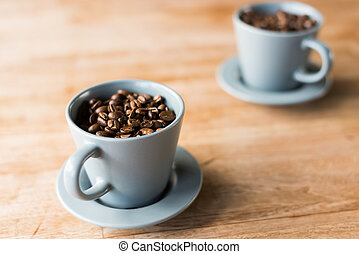 cup of coffee beans on the wooden table