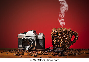 The coffee cup which is made with coffee beans. Film camera and glasses.