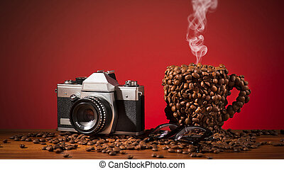 The coffee cup which is made with coffee beans. Film camera.