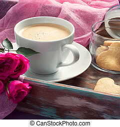 Cup of coffee, cookies and rose. Concept of Valentine's Day brea