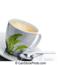 cup of coffee decorated with stevia rebaudiana leaves, plus a spoon. White background border of a page, left angle