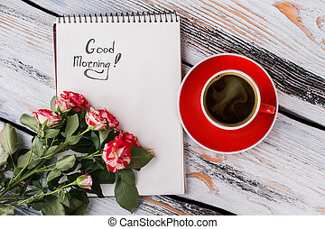 Cup of coffee, hybrid rose flowers and good morning note. ...