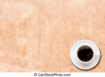 Cup of coffee in a white cup on paper texture