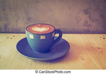 cup of coffee in coffee shop vintage color tone