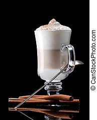 cup of coffee latte macchiato on a black background