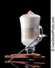 latte macchiato - cup of coffee latte macchiato on a black ...