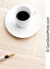 cup of coffee near a golden pen