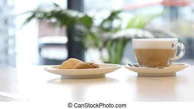 Cup of coffee near the plate with cookie - Transparent cup...