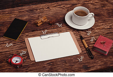 cup of coffee, notebook, pen, phone on desk