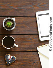 cup of coffee, notepad, tablet