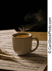 Cup of coffee on a music score.