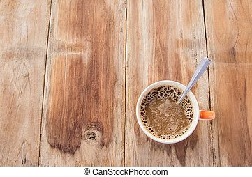 Cup of coffee on a old wooden table